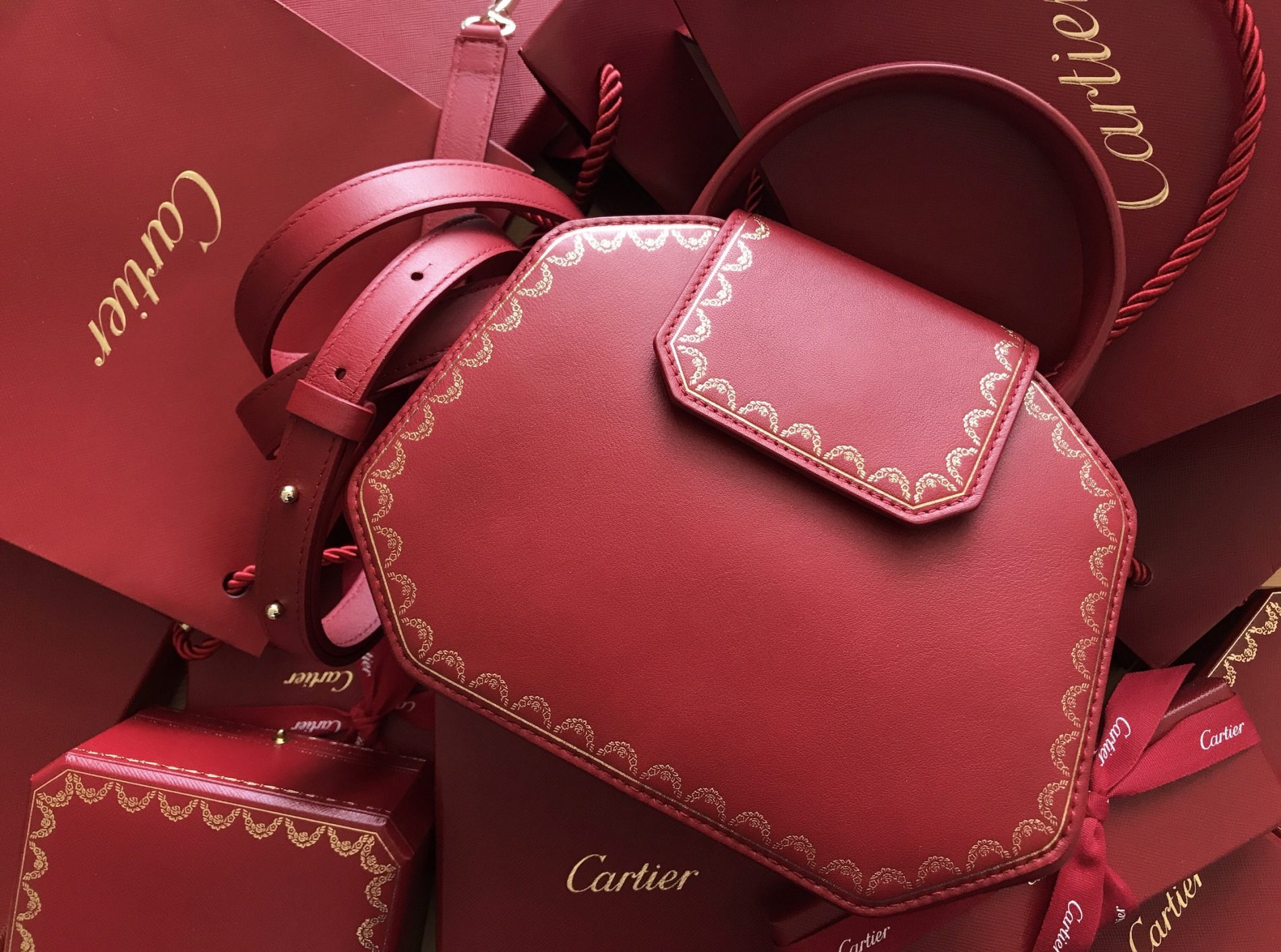 Cartier launches a new bag collection – the Guirlande de Cartier – inspired  by its iconic jewellery boxes. 7eaf28b646d
